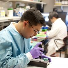 NCI lab technician using a MicaArray prototype